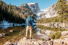 Tourist near Dream Lake in Colorado. Tourist near Dream Lake at autumn in Rocky Mountain National Park. Colorado, USA Stock Photography