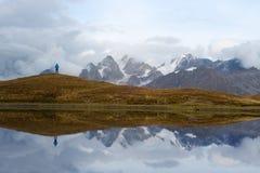 Tourist near a mountain lake Stock Photo