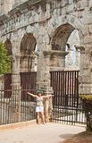 Tourist near the Roman amphitheater in Pula, Croatia Royalty Free Stock Images