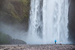 Tourist near Skogafoss waterfall, Iceland royalty free stock images