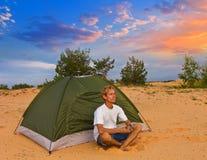 Tourist near a tent Stock Photos