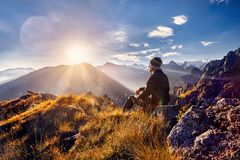 Tourist in the mountains at sunrise Royalty Free Stock Images
