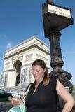 A tourist nera the Arc de triomphe. A view of the arc de triomphe in paris Royalty Free Stock Images