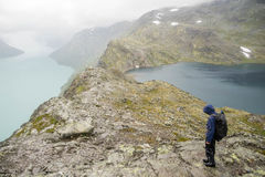 Tourist in Norway hiking path Royalty Free Stock Image