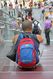 Tourist in NY. Tourist from Russia with a backpack sitting on the stairs in Times Square Royalty Free Stock Images