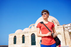 Tourist in the old town. Woman tourist walking in the old town, Crete, Greece Stock Photo