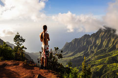 Tourist overlooking Kalalau Valley - Kauai, Hawaii Royalty Free Stock Image