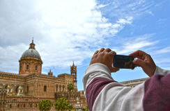 Tourist  Palermo - Sicily. Tourist takes photos of the Cathedral of Palermo - Sicily Stock Photography