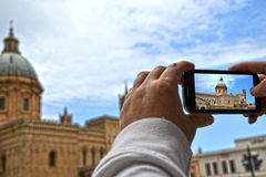 Tourist  Palermo - Sicily. Tourist takes photos of the Cathedral of Palermo - Sicily Royalty Free Stock Photography