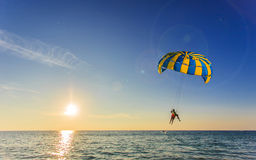 Tourist is para sailing over the blue sea in Thailand Royalty Free Stock Photos