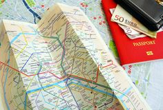 Tourist in Paris concept. Finding the way around Paris - A conceptual photograph showing a tourist map of Paris, France, and a Metro station map; taken with an Royalty Free Stock Photo