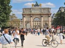 Tourist in Paris, France. Paris, France - July 9, 2015: Tourists visit L'Arc de Triomphe du Carrousel, major attraction in central Paris, France Stock Photography