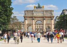 Tourist in Paris, France. Paris, France - July 9, 2015: Tourists visit L'Arc de Triomphe du Carrousel, major attraction in central Paris, France Royalty Free Stock Images