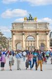 Tourist in Paris, France. Paris, France - July 9, 2015: Tourists visit L'Arc de Triomphe du Carrousel, major attraction in central Paris, France Stock Photo