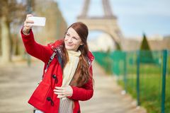 Tourist in Paris near the Eiffel tower Royalty Free Stock Photo