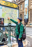 Tourist in Paris, near the subway plan royalty free stock photos