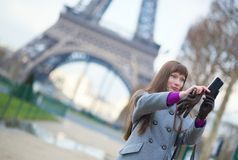 Tourist in Paris taking a picture of herself Royalty Free Stock Photos