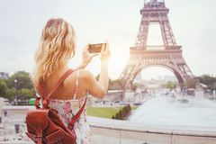 Tourist in Paris visiting landmark Eiffel tower, sightseeing in France, mobile photo on smartphone stock photo
