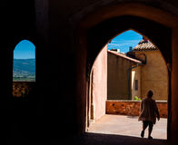 Tourist on passages arcs and windows in Roussillon in France Stock Photo