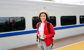 Tourist passengers traveling with China high-speed train. Is a quick and easy affair due to the high speed rail royalty free stock image