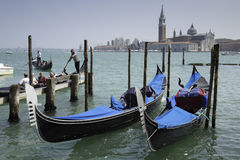 Tourist people and gondolas docked to the poles on the Grand Canal Royalty Free Stock Photos
