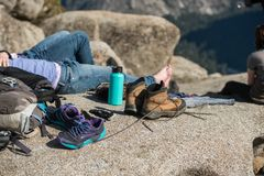 Tourist people resting in camp and dry the shoes after mountain hiking in yosemite national park. Royalty Free Stock Photography
