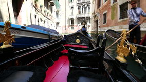 Tourist people sailing with gondola through the city streets of Venice, Italy stock video footage
