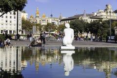 Tourist people sitting near Catalonia Square Stock Photography