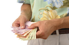 Tourist with pesos Stock Photography