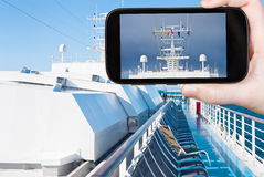 Tourist photograph flags on cruise liner Stock Photography