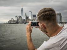 Tourist photograph the New York City skyline Stock Image