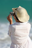 Tourist photographer. Tourist takes a photo while on vacation royalty free stock photos