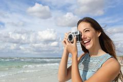 Tourist photographer girl taking photo in holidays Royalty Free Stock Photos