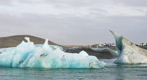 Tourist photographers take photo of glacier ice lagoon Stock Photo