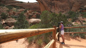 Tourist photographing in Arches National Park stock video footage