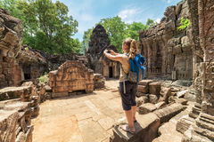 Tourist photographing the bas-relief in Angkor, Cambodia Royalty Free Stock Photography