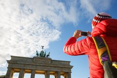 Tourist photographing Brandenburg gate, Berlin royalty free stock photos