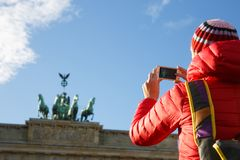 Tourist photographing Brandenburg gate, Berlin stock images