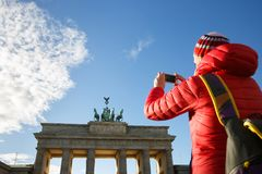Tourist photographing Brandenburg gate, Berlin stock photography