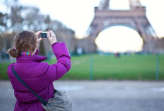 Tourist photographing the Eiffel Tower Stock Images
