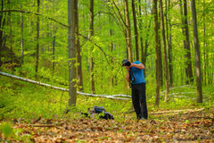 Tourist photographing the forest Royalty Free Stock Image