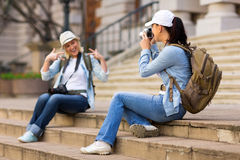 Tourist photographing friend Stock Photo