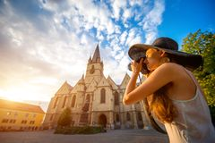 Tourist photographing ghotic cathedral in Romania Stock Image