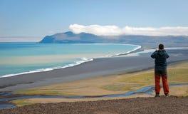 Tourist photographing Icelandic landscape stock photos