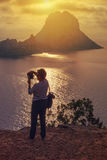 Tourist photographing the islets of Es Vedra and Es Vedranell, I Stock Image