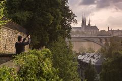 Tourist photographing Luxembourg city Royalty Free Stock Photo