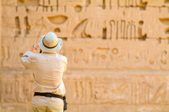 Tourist photographing-Medinet Habu Temple Egypt. Egypt, Upper Egypt, Nile Valley, Gaugue bank of Thebes, about Luxor, Medinet Habu Temple classified World stock photography