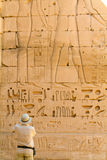 Tourist photographing-Medinet Habu Temple Egypt Stock Photography