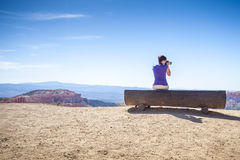 Tourist photographing nature in Bryce Canyon National Park Royalty Free Stock Photography