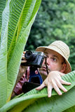 Tourist photographing in nature Royalty Free Stock Image